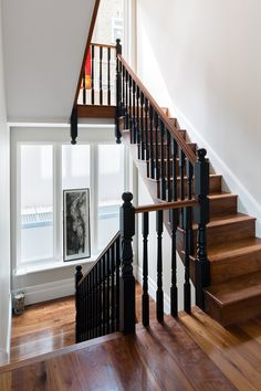 Barnes Townhouse - Granit Timber clad traditional style staircase with black painted spindle and newel posts. Full house refurbishment and extension in Barnes, South West London.