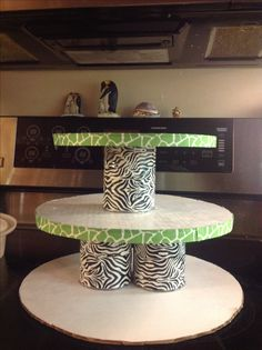 DIY cupcake tower. I made this from cardboard cake boards, soup cans, duct tape, and ribbon! I wanted animal theme, but I could not find one to match our theme. Besides, it was MUCH cheaper and sturdier than the ones you buy.