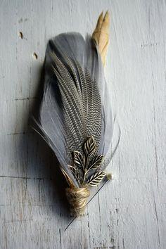 ooooooooooooo love the gray feather