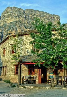 Stay in a pension under the impressive Tymfi Massif, in Vikos village, Zagoria, north Pindus Mountains (Pindos or Pindhos), Epirus/Epiros, Greece, Europe. The northeast wall of Vikos Gorge is Mount Tymfi (or Greek: , also transliterated Timfi, Tymphe, or Tymphi), near the 40 degree parallel. Tymfi forms a massif with its highest peak, Gamila, at 2497 meters (8192 feet), the sixth highest in Greece. Vikos Gorge in northern Greece is the world's deepest canyon in proportion to its width…