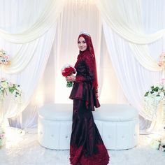 Deep red songket for Majlis Bertandang
