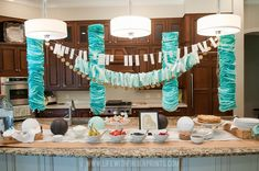 Make your own fancy garland for your next party; a coffee filter garland tutorial with easy to follow instructions. Make it in any color!
