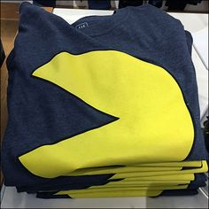 Though a bit old school, Pac-Man is still a well-known theme. And who knows, maybe the trademark has run out and he is public domain, or licensing fees are low on this venerable icon of the digital age Pac Man, Old School, Retail, Sweatshirts, T Shirt, Tee, Retail Merchandising, Plush, Tee Shirt
