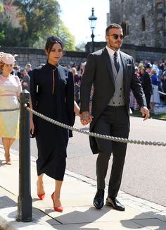 Victoria Beckham in Victoria Beckham. David Beckham in Dior Homme. A First Look at Prince Harry and Meghan Markle's Fairy-Tale Wedding Flowers Inside St. George's Chapel