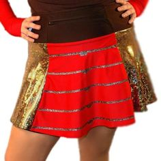 "The perfect Avengers running costume skirt, this shimmery gold foil skirt has a red panel down the front where we apply sparkly gold lines, helping you channel the Iron Guardian himself. The black, wicking anti-ride undershorts carry two 6x6"" pockets for all your energy fuel. The 12"" zippered pocket in the waistband holds valuables safely and securely. Originally starting at $85 (varies depending on size), now reduced to $80! Non-returnable."