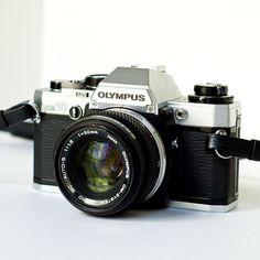 35Mm Camera   1980s Olympus OM10 35mm SLR camera with 50mm f1.8 lens and original ...