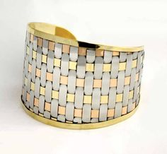 3-Tone Woven Wrist Cuff Take your elegance up a level with this interwoven gold, silver and copper-colored cuff.