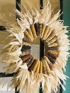 Awesome Thanksgiving/Harvest wreath made of multi colored Indian corn! Definitely doing this this year!