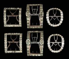 Three pairs of 18th c. shoe buckles the first of greenish foil-set cut pastes set in pinchbeck, with blued steel chapes, with a rosette at each side; another simple square shaped cut paste buckles; and a third pair of oval cut paste buckles (3).