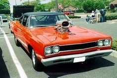 """1968 Plymouth Roadrunner with a 440 bored .60 over, 11.5:1 compression, .600"""" lift Crane Cam, roller rockers, steel billet connecting rods, two 650 CFM Holley double pumper carburetors, an 871 Blower, a JPT prepared reverse manual valve body Torqueflite, 4,000 RPM stall speed torque converter, and a narrowed 8 3/4 rear end with 4.88:1 Richmond gears. Driven on the street during the week, and on the track on Sunday."""
