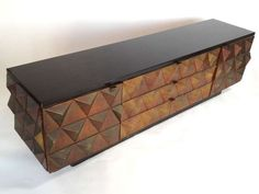 Exceptional Brutalist Style Faceted Credenza | From a unique collection of antique and modern credenzas at https://www.1stdibs.com/furniture/storage-case-pieces/credenzas/