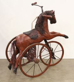 Victorian style wood and metal toy horses comprising a tricycle and a rocking horse
