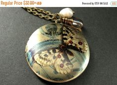 SUMMER SALE Locket Necklace. Butterfly Necklace. Moth Necklace with Fresh Water Pearl and Taupe Teardrop. Handmade Jewelry. by TheTeardropShop from The Teardrop Shop. Find it now at http://ift.tt/2somZrm!