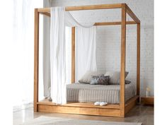 I've always wanted a canopy bed and I love this modern take on it.