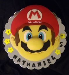 "For a 5 year old that LOVES Mario :) double 12"" round cakes carved. TFL"