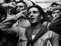 SPAIN. 1938. Bidding farewell to the International Brigades, which the Republican government dismissed. Robert Capa. Photographer. who covered five different wars: the Spanish Civil War, the Second Sino-Japanese War, World War II across Europe, the 1948 Arab-Israeli War, and the First Indochina War.