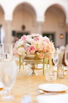 Loving the soft floral hues and antique silver vase in this centerpiece!