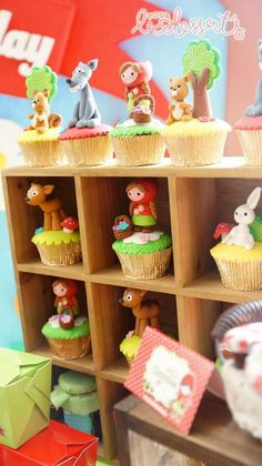 Adorable Cupcakes at a Little Red Riding Hood Party with Such Cute Ideas via Kara's Party Ideas   KarasPartyIdeas.com #LittleRedRidingHood #woodland #BigBadWolf #PartyIdeas #PartySupplies #cupcakes