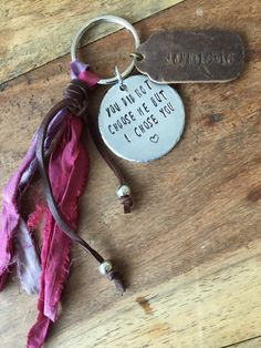 A personal favorite from my Etsy shop https://www.etsy.com/listing/255149845/boho-keychain-scripture-personalized