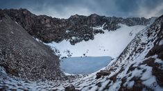 High in the Himalayas of India, amid the snow-capped peaks, nestles a mystery. Roopkund Lake is a shallow body of water filled with human bones - the skeletons of hundreds of individuals. It's these that give the lake its other name, Skeleton Lake, National Geographic, Monument Valley, Monuments, Formations Rocheuses, Road Trip, Creta, University Of Kansas, Sea Level, Pilgrimage