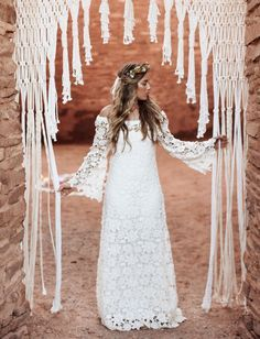 This crochet lace wedding dress is perfect for the boho beach bride!