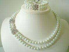 Bridal Rhinestone Pendant with White Pearls Beaded Necklace Bracelet and Earring Set. $45.00, via Etsy.
