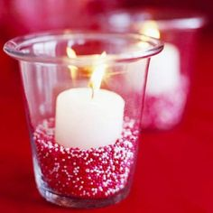 Alluring Candle Designs for Romantic Ambience: Beautiful candle designs with red and white ornaments with transparance glass candle holders for table decorating plans with vivacious napery