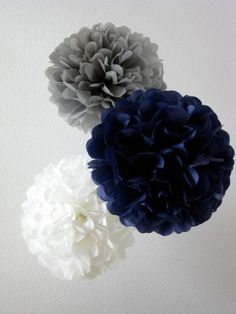 Festive blue and gray pom poms for an adult birthday party decor