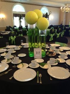 tennisball table centerpieces | Tall cylinder vases with large tennis balls look modern and ...