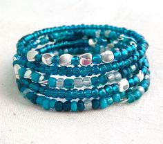 A personal favorite from my Etsy shop https://www.etsy.com/listing/236504621/teal-bracelets-memory-wire-bracelet