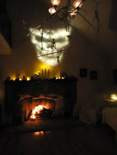 halloween atmospheric - love this. skeleton décor, candle glow, lights, fire