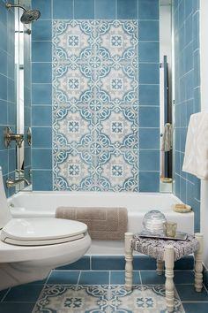 custom colored cement tiles, generously offered by Filmore Clark mirrored edges and Brizo faucets.MehditashDesign: Jennifer Mehditash for RonaldMcDonald House Photo:StaceyvanBerkel Styling:RainaKattelson Filmore Clark tiles Bad Inspiration, Bathroom Inspiration, Blue Bathtub, Moroccan Bathroom, Moroccan Tiles, Brown Bathroom, Aqua Bathroom, Blue Tiles, Bathroom Pictures