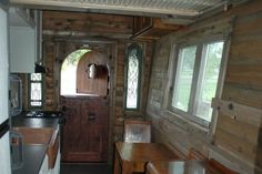 The interior looks pretty old school with its wood-paneled walls, antique furniture and curlicued copper sink.#TinyHouseforUs