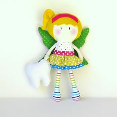 "My Teeny-Tiny Dolls® are 11"" Handmade Fashion Dolls. Made from cotton and wool felt fabrics, filled with polyfil for softness.MTTD Rainbow Tooth Fairy Doll®'s fairy wings, ruffle skirt and tooth pouch are all removable.Due to the handmade nature of the doll, recommended for children 3+. Children should be supervised during play.© Cook You Some Noodles 2015"