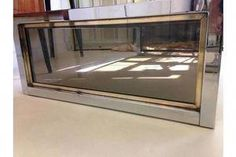 Large chrome coffee table Brass banding Smoked glass top and sides Possibly Italian Shop our full collection of Tables here at Vinterior Nyc Coffee Shop, Home Coffee Machines, Brass Coffee Table, Good Dates, Entryway Tables, Chrome, Glass, Coupon, Home Decor