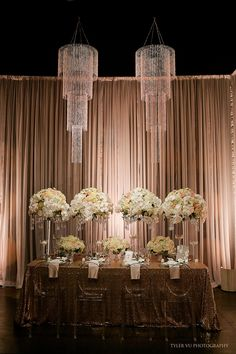 Draw more attention to your guest tables with chandeliers over them. These would look stunning at your glitzy wedding reception. Chandelier Wedding Decor, Wedding Table Decorations, Wedding Chairs, Wedding Centerpieces, Chandelier Centerpiece, Bead Chandelier, Stage Decorations, Chandeliers, Gold Wedding