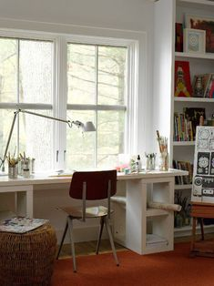 love this work space with the tin can pencil holders and wide desk space with open shelving and natural lighting.  perfect for feeling inspired.