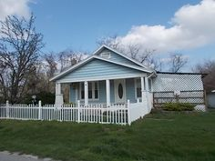 This property is a 2 bedroom 1 bath doll house with a fenced yard to keep pets or children in. It also sports a 2 car detached and a 1 car detached garages. Located in Louisburg, a quaint quiet town just a few miles north of Buffalo MO