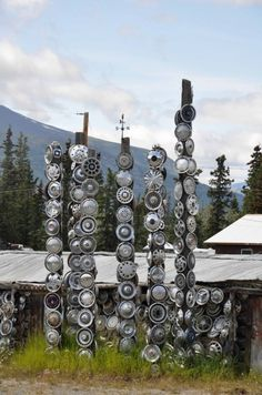 metals hubcaps on wood post totems