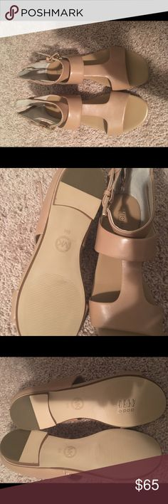 Michael kors sandals New never worn but no box, trying to clean up my closet. Size 8, very stylish in beige color Michael Kors Shoes Sandals