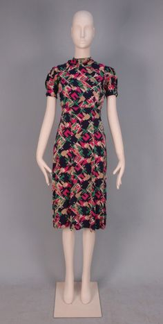 SCHIAPARELLI FABRIC DRESS, c. 1940.
