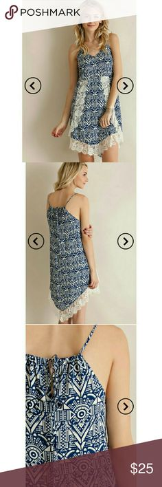 Lace detailed summer dress. An aztec print slip dress featuring eyelash lace details on hem. Adjustable straps. Partially lined. Non-sheer. Woven. Light weight. 100% rayon. Navy blue and ivory. All retail items are firm. entro Dresses Mini