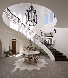Suzie: Spanish style home with 2-story foyer, marble top foyer table, winding staircase and ...
