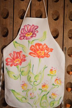 You might as well look good in the kitchen. Wear a piece of art! Great gifts!  All fabrics are painted with water based fabric paint and set to wear.