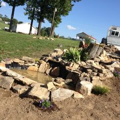 Homemade fountain pond,except without all the plastic. we want it as natural as possible