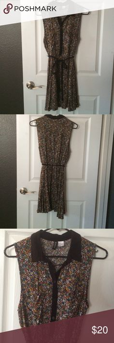 Fun sleeveless dress with front pockets button up Worn a bit but still in great condition. Very week loved. Bright yellow pink lavender blue and white flowers over black background. Black buttons and color and ribbon detail. H&M Dresses Midi