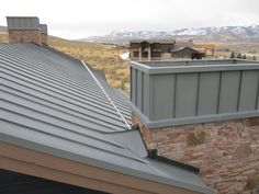 Zinc standing seam roof with zinc chimney and stainless steel snow abatement system Zinc Roof, Metal Roof, Snow Fence, Standing Seam Roof, Chimney Cap, Beams, Stairs, Construction, Stainless Steel