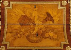 Close up of a cabinet used by Louis XVI at the Petit Trianon. Designed by Jean-Henri Riesener in 1777, it features inlaid wood and carved bronze. Discover more about 18th Century France at http://leahmariebrownhistoricals.blogspot.com