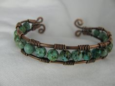 wire wrapped cuff bracelet.    Kristy--Holly K. might could do this one in your colors???