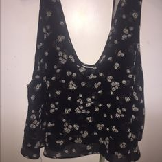 Black with daisy print flowy crop top Only worn 3 times and is a nice chiffon material with a trendy daisy print. Tank top with a low v neck which is nice to wear with bralettes! Size large but can fit medium too! Garage Tops Tank Tops
